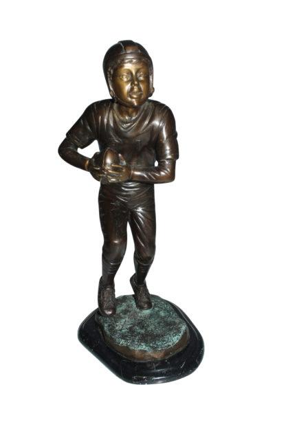 "Boy playing football Bronze Statue -  Size: 10""L x 8""W x 20""H."