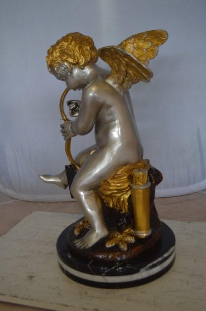 "Cupid Boy On A Rock Bronze Statue  -  Size: 20""L x 15""W x 26""H."