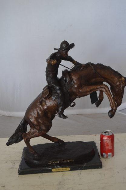 "Bronco Buster Bronze Statue by Remington -  Size: 9""L x 24""W x 21""H."