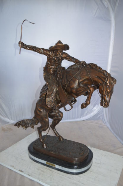 "Jumbo Bronco Buster  by Remington Bronze Statue -  Size: 19""L x 11""W x 36""H."