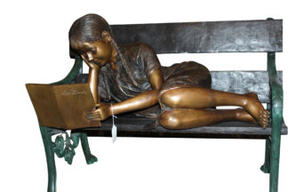 "Girl laying on a bench reading a book Bronze Statue -  Size: 27""L x 39""W x 32""H"