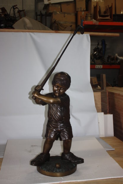 "Golfer Boy Bronze - Big shoes -  Size: 18""L x 14""W x 49""H."