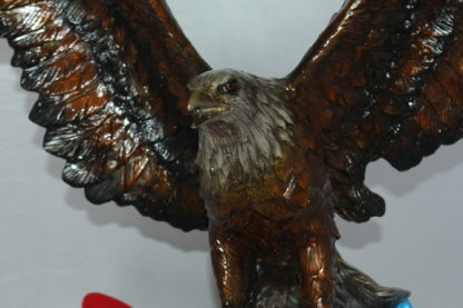 "Eagle with American Flag Bronze Statue -  Size: 32""L x 14""W x 35""H."