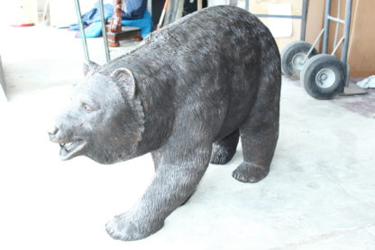 "A bear walking Bronze Statue -  Size: 39""L x 12""W x 24""H."