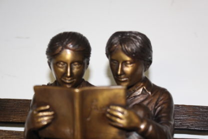 """Two kids on bench reading a book - Bronze Statue -  Size: 9""""L x 6""""W x 8""""H."""