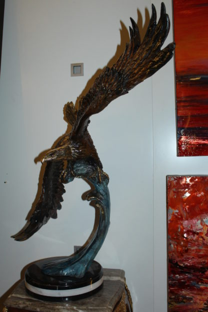 "Eagle on a wave - Bronze Statue -  Size: 32""L x 12""W x 34""H."