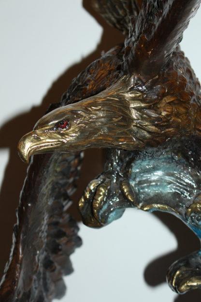 "Eagle on a wave - Bronze Statue -  Size: 32""L x 12""W x 34""H."