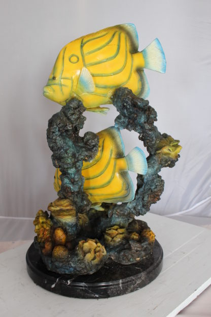 "Two Butterfly fish swimming bronze statue -  Size: 12""L x 12""W x 24""H."