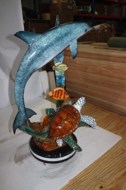 "Dolphin with two fish and one turtle Statue -  Size: 22""L x 12""W x 32""H."