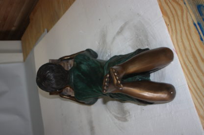 "boy laying reading book bronze Statue -  Size: 24""L x 10""W x 11""H."