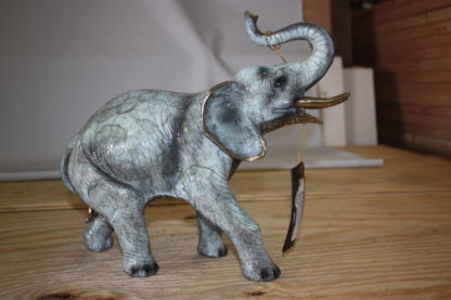 "Elephant with trunk up -  Statue -  Size: 13.5""L x 5""W x 12""H."