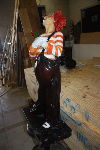 """Standing clown with flowers - Bronze Statue -  Size: 21""""L x 10.5""""W x 38""""H."""
