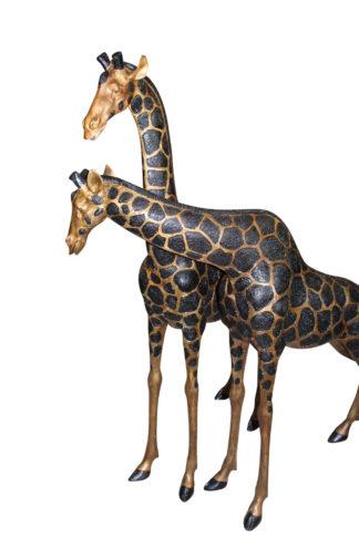 "Pair of Giraffes Bronze Statues -  Size: 32""L x 12""W x 55""H."