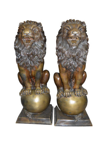 "Pair of lions standing on balls, bronze statues -  Size: 14""L x 16""W x 38""H."